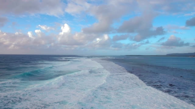Seascape with foamy waves of blue Indian Ocean, aerial view video