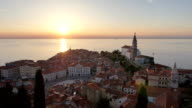 AERIAL: Seaside town with city square and church at sunset video
