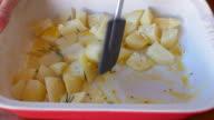 seasoning diced potatoes for roasting video