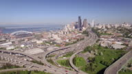 Seattle, WA 4-20-16: Aerial Pan of Freeway and Downtown City Buildings with Safeco Field and Century Link Stadium video