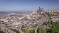 Seattle, WA 4-20-16: Rising Aerial of Freeway with Downtown Skyline and Century Link Field Stadium video