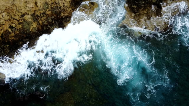 Seaway. Waves crashing pure stone coast. Drone Point of View . clear blue clear water video