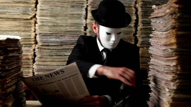 Secret Agent Reading Newspaper In Dark For Censorship video