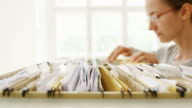 Secretary Searching Files video