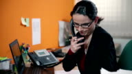 HD STOCK: Secretary talking on a phone in her office video