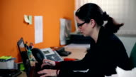 HD STOCK: Secretary typing on laptop in her office video