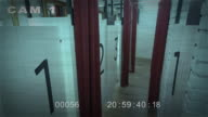 CCTV security cam timelapse footage of people in a fitting room in a department store. video