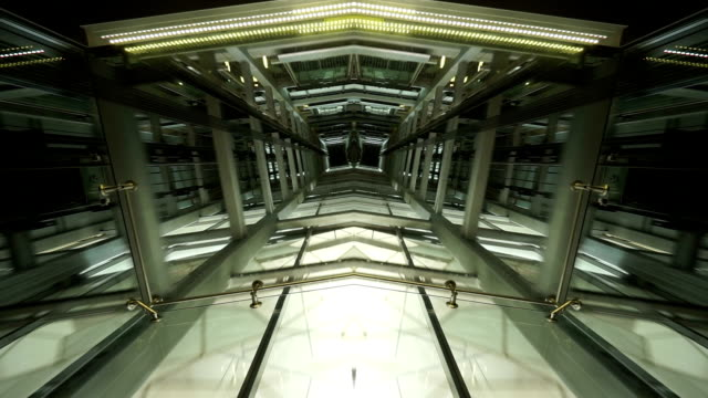 See through ceiling of elevator carriage showing elevator shaft and movement video