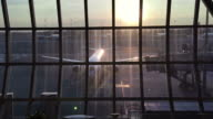 See through glass window at air port video