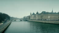 Seine river and famous Conciergerie, former prison and present law courts place in Paris, France. FullHD pan shot video