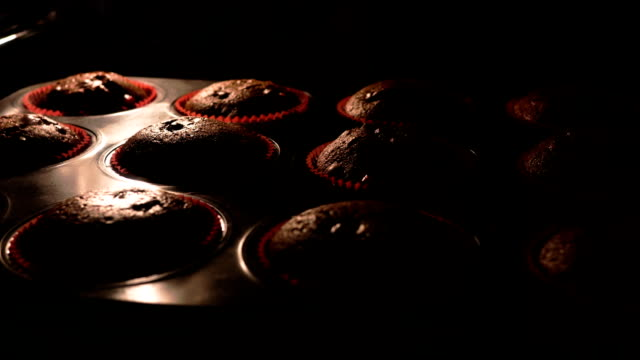 Selective focus shot of muffins baking, time-lapse video