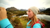 Self portrait of a young female hiking in Autumn. video