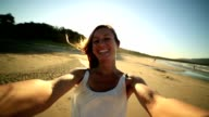 Self portrait of hipster girl on beach at sunset video