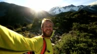 Self portrait of young man hiking in New Zealand video