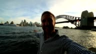 Self portrait of young man with Sydney skyline video