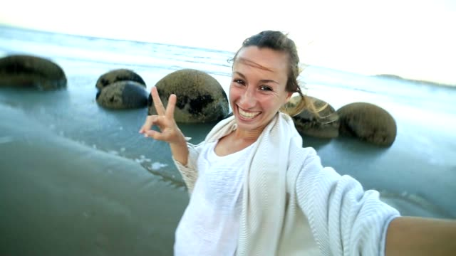 Self portrait of young woman at the Moeraki boulders-New Zealand video