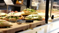 Self service canteen counter with sandwiches and pizza video