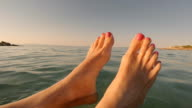 Selfie Beach Feet. Woman relaxing floating in the water. video