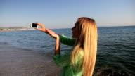 Selfie & blowing a kiss on beach video