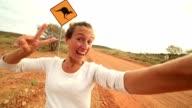 Selfie of young woman in Australia standing near kangaroo sign video