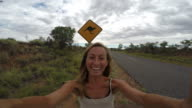 Selfie of young woman in Australia standing near kangaroo sign-4K video