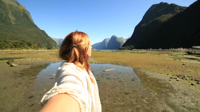 Selfie point of view, woman in mountain scenery video