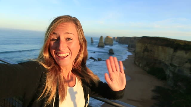 Selfie portrait at sunrise of woman at the Twelve Apostles video