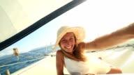 Selfie portrait of blond girl on sailing boat video