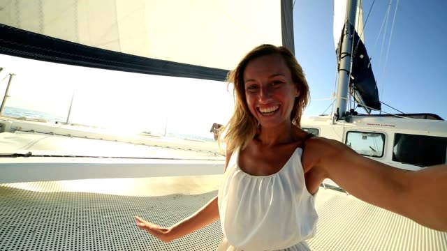 Selfie portrait of blond girl on sailing boat video