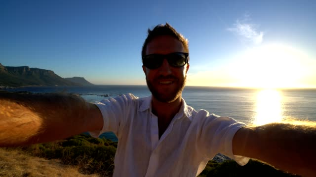 Selfie portrait of young man by the sea, Cape Town video