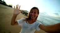 Selfie portrait of young woman on the beach video