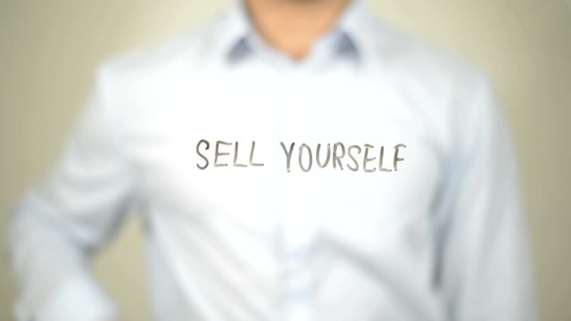 Sell Yourself, Man Writing on Transparent Screen video
