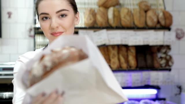 Seller giving the fresh baked video