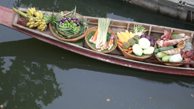 Selling fruits and vegetables in floating market, Thailand video