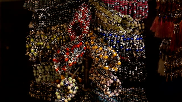 selling jewelry bracelets with Nazar amulet on the market in Istanbul video