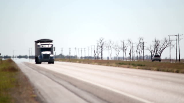 Semi Truck Driving Down The Highway video