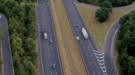 AERIAL: Semi trucks and personal cars speeding on interstate in the morning video