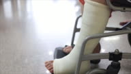 Senior adult leg injury sitting on wheelchair video