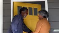 Senior African American couple arriving home, opening front door video