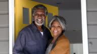 Senior African American couple in doorway, smiling video