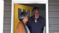 Senior African American couple opening door and leaving house video
