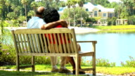 Senior African American Couple Sitting Park Bench video