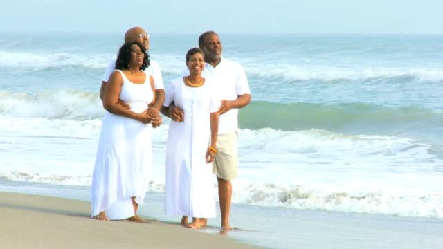 Senior African American Friends Walking Beach video