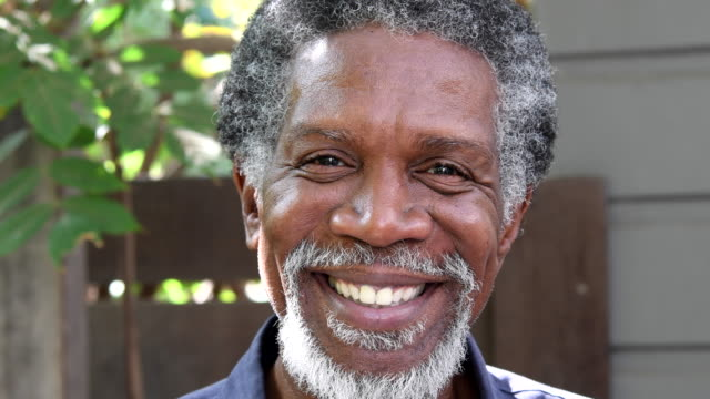 Senior African American man looking at camera and smiling video