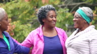 Senior African American women greeting, hugging at park video