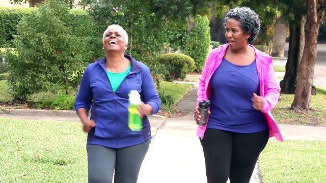 Senior African American women power walking, talking video