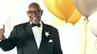 Senior African-American man wearing black tuxedo video