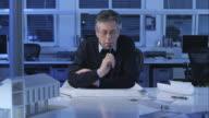 DS Senior architect pondering over the design plans video