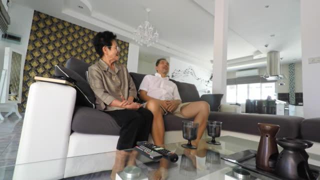 Senior Asian Couple Talking At Home video