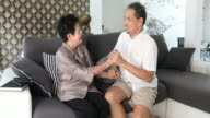 Senior Asian Couple Talking At Home video
